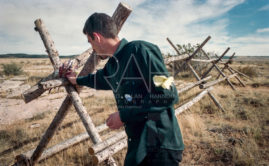 Graham Baxendale, a visiting lecturer at the University of Wyoming on hate crimes from Reading, England, finds an opportunity during lunch to pause where Matthew Shepard was tied to a buck-and-rail fence a mile northeast of Laramie.