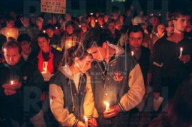 A couple participates in a 1000-person vigil at St. Paul's Newman Center across from the University of Wyoming in Laramie, Wyo. Sunday, October 11, 1998, to support U.W. Matthew Shepard. Shepard, 21, who was openly gay, was beaten, burned, tied to a fence, and left for dead in the early morning hours of Wednesday, October 7, 1998.  Hours after the vigil, Shepard died at Poudre Valley Hospital in Fort Collins. Colo., October 12, 1998.