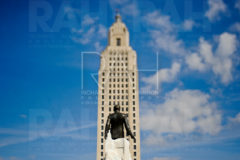 Gov. Huey Long statue with the Louisiana State Capitol Building.