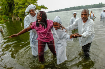 Members of several Lake Providence, La. area black baptist churches unite on a bank of Lake Providence, La. for their annual baptism, Sunday, July 29, 2007.