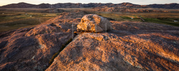 First light hits the top of Independence Rock along the Mormon Trail.