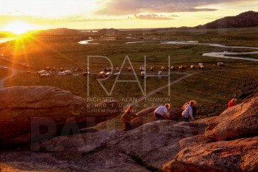 People journey across the high plains, including to the top of Independence Rock in Wyoming at sunrise, to commemorate the 150th anniversary of the opening of the Mormon Trail on July 21, 1997.