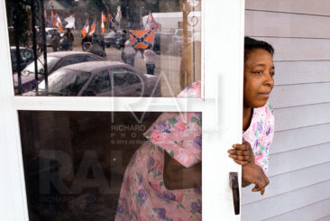 """It really don't make any sense, they should let it die"" says Margarita Preston of Columbia as she watches the beginning of the Southern Heritage Celebration 2000 parade march past her Wayne Street home in January en route to the State House.  Photo by Richard Alan Hannon"
