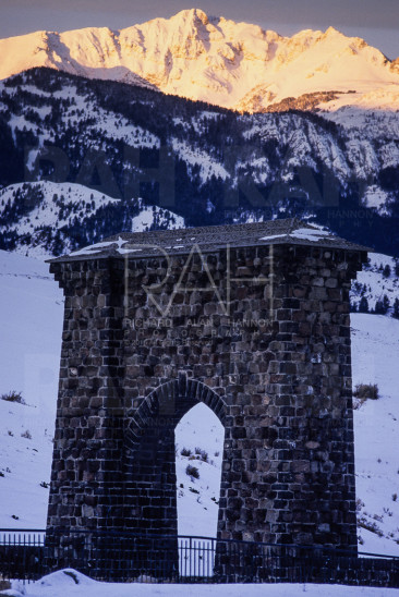 Roosevelt Arch at sunrise. North entrance to Yellowstone National Park.