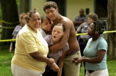 Ivory Stewart, center, comforts his sisters Shon Stewart, front, and Byrd Stewart Friday upon learning their brother was murdered. The victim's mother Sharon Stewart, left, and Ivory's God-sister Nikki Thomas, right, look on. Israel Stewart and Keish Bradley were found dead in their home Saturday.