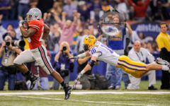 Ohio State's Beanie Wells, left, rushes for a touchdown past LSU's Craig Steltz (16) during the first half of the BCS national title game Monday Jan. 7, 2008, in New Orleans.