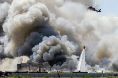 Firefighters attempt to douse a three-alarm blaze at two abandoned Port of New Orleans wharfs along the Mississippi riverfront Wednesday. The fire began at the Orange Street Wharf and stretched to the Market Street Wharf.