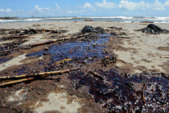 Pools of oil coat sections of Fourchon Beach in Lafourche Parish Saturday.
