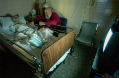 Inmate hospice volunteer Ted Durbin stays with David Mackey's during the early-morning hours.