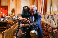 House Assistant Sergeant-at-Arms Daniel Carter receives a hug from Rep. Barbara Norton, D-Shreveport, at the close of a one-week special session.