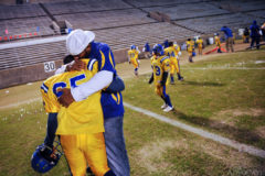 South Baton Rouge Jaguars Division A head football team coach Terry Boyd hugs nine-year-old Ronald Sims following his team's 19-6 win over the Scotlandville Hornets during the 2008 Louisiana Youth Football League championship game at Memorial Stadium in Baton Rouge Saturday November 22, 2008.