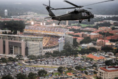 A Louisiana National Guard Black Hawk helicopter carries Louisiana Gov. Bobby Jindal past Louisiana State University's Tiger Stadium during an LSU college football game against North Texas in Baton Rouge, La. Saturday, Sept. 13, 2008. The Governor had just flown over the flooded Louisiana towns of Erath, Delcambre and Lake Charles following the landfall of Hurricane Ike.