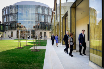 Visitors, including Joe and Susan Winkler, third and second from right, and Marty Phillips, far right, walk through the new LSU E.J. Ourso College of Business Business Education Complex for the first time prior to a ribbon cutting ceremony in Baton Rouge Friday.