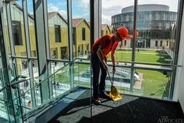 Thomas Morgan with Cenikor of Baton Rouge makes a last-minute cleanup prior to the start of a ribbon cutting ceremony for the new LSU E.J. Ourso College of Business Business Education Complex in Baton Rouge Friday.