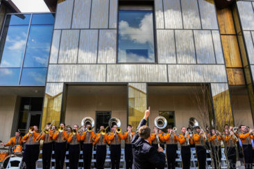 The LSU pep band, led by director Roy King, center, plays the Star Spangled Banner at the start of a ribbon cutting ceremony for the new LSU E.J. Ourso College of Business Business Education Complex during its unveiling in Baton Rouge Friday.