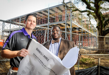 Paul Stevenson, general manager of the LSU bookstore, and Jason Rex Tolliver, executive director with LSU's finance and administrative services department, stand in front of what will be a Barnes & Noble bookstore, parking garage and Apple store all now under construction on campus in Baton Rouge Friday, February 2, 2012.