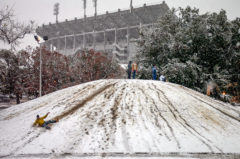 LSU students slide on fresh snow down the Indian Mounds on campus in Baton Rouge on December 11, 2008.