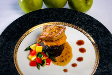 Bacon Larded Venison Tenderloin layered with Seared Foie Gras and Granny Smith apple fries, Cognac cream sauce and balsamic pomegranate reduction.
