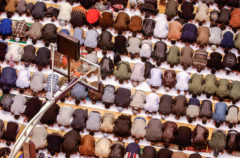 Approximately 500 Muslims from throughout the Baton Rouge, Louisiana area bow in communal prayer on Tuesday, February 11, 2003 to celebrate Hajj, marking the end of the yearly pilgrimage to Mecca. The prayers, and the holiday that follows, are called Eid ul-Adha, or 'festival of the sacrifice', which commemorates the Prophet Abraham's willingness to sacrifice his son Ishmael at God's command. (AP Photo/The Advocate, Richard Alan Hannon).