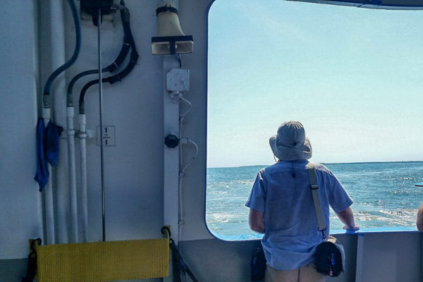 Richard Alan Hannon recording sound at the rear of a ferry boat headed to South Bass Island. September 5, 2016. Photo by Kathie Mong