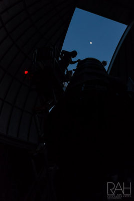 """Dan Everly, Warren Rupp Observatory night sky coordinator, adjusts the eyepiece to """"Big Blue,"""" a 36-inch Newtonian telescope, to get a get a close-up view of the moon's craters on Saturday, July 1, 2017. Photo by Richard Alan Hannon"""