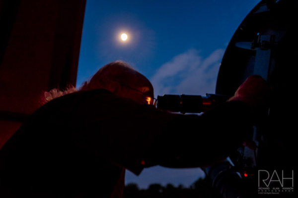 Warren Rupp Observing Night Sky Coordinator Dan Everly peers at the waxing moon - 80.42% full - at the observatory in Bellville, Ohio August 1, 2017. Photo by Richard Alan Hannon